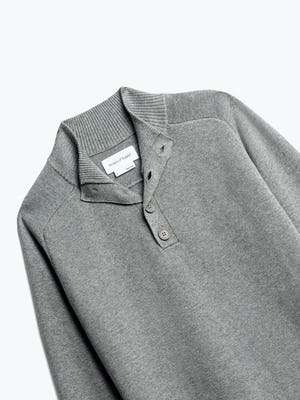 close up of men's light grey atlas merino button collar shot of front