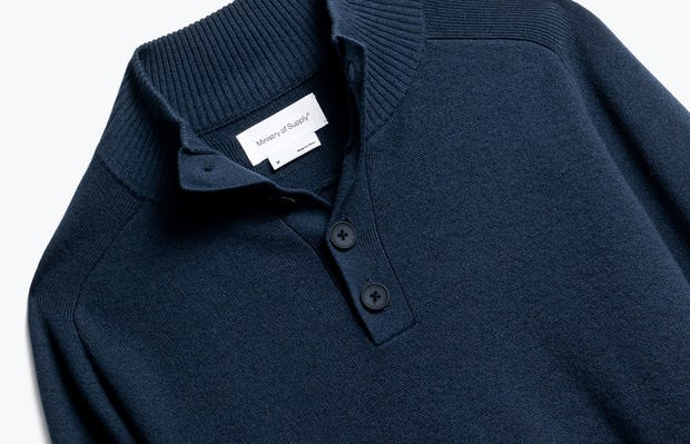 close up of men's navy atlas merino button collar shot of front