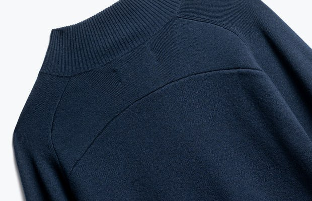 close up of men's navy atlas merino button collar shot of back