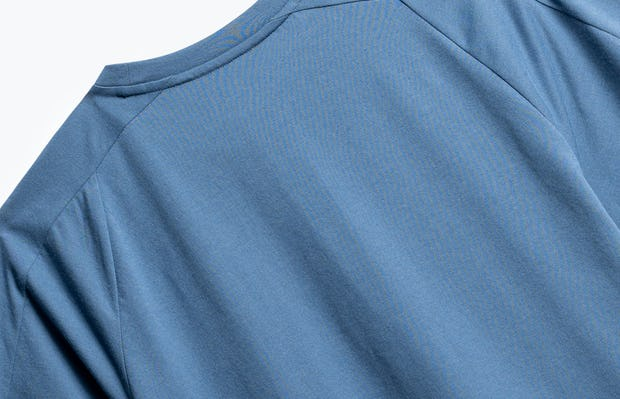 close up of men's storm blue composite active tee shot of back