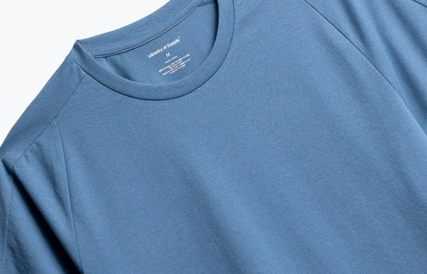 close up of men's storm blue composite active tee shot of front