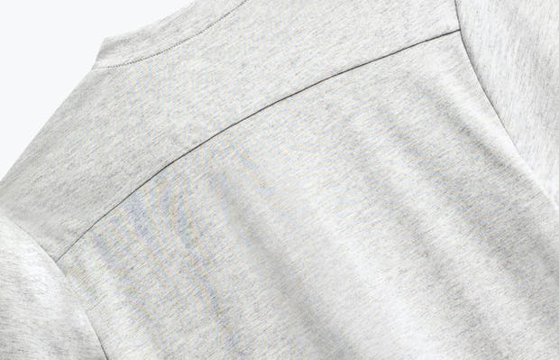 close up of men's grey heather recycled composite merino short sleeve henley shot of back