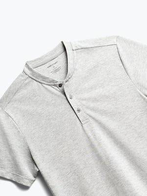close up of men's grey heather recycled composite merino short sleeve henley shot of front