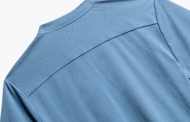 close up of men's storm blue composite merino short sleeve henley shot of back