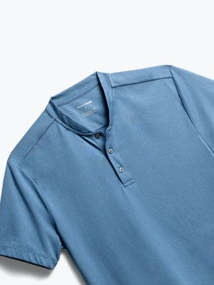 close up of men's storm blue composite merino short sleeve henley shot of front