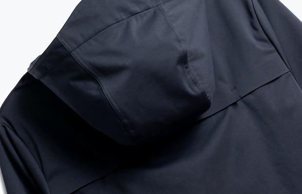 close up of men's navy doppler packable jacket shot of back
