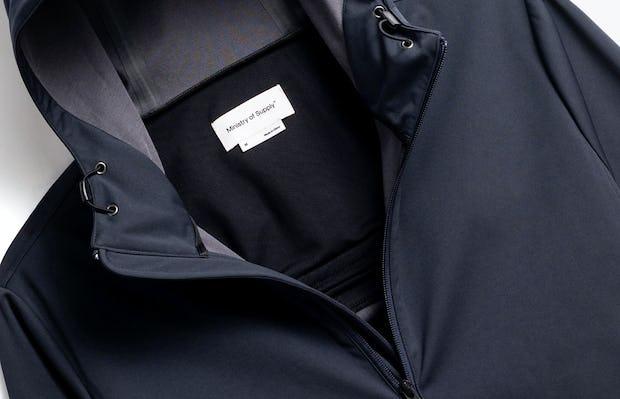 close up of men's navy doppler packable jacket shot of front