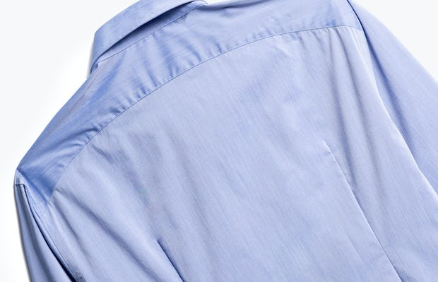 close up of men's blue gemini button down shot of back