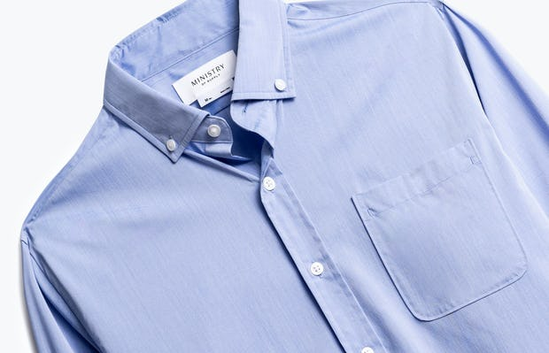 close up of men's blue gemini button down shot of front