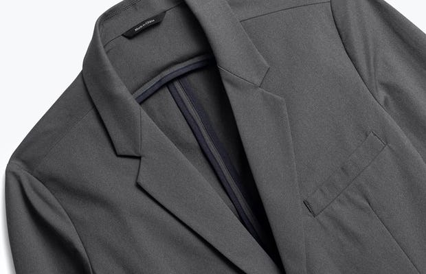 close up of men's charcoal heather kinetic blazer shot of front