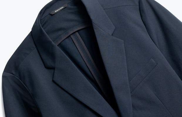 close up of men's navy kinetic blazer shot of front