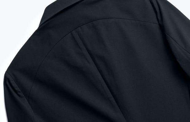 close up of men's black kinetic blazer shot of back