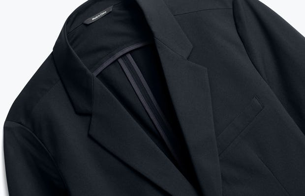 close up of men's black kinetic blazer shot of front