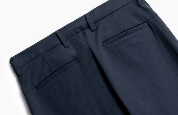 close up of men's navy kinetic pant shot of back