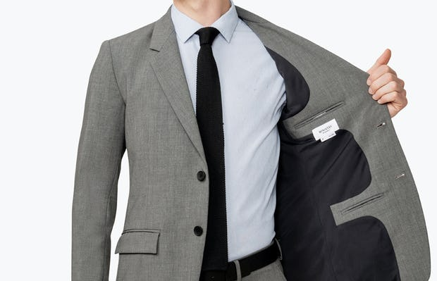 Men's Grey Velocity Suit Jacket on model facing forward showing inside of jacket