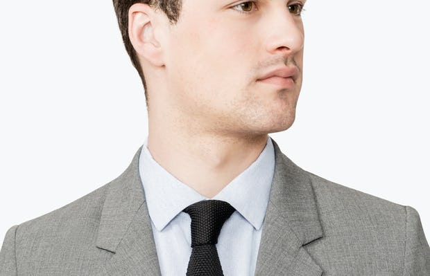 Close up of Men's Grey Velocity Suit Jacket on model facing forward
