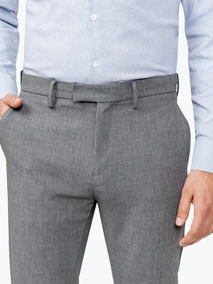 Close up of Men's Grey Velocity Pant on Model Facing forward with hand in pocket
