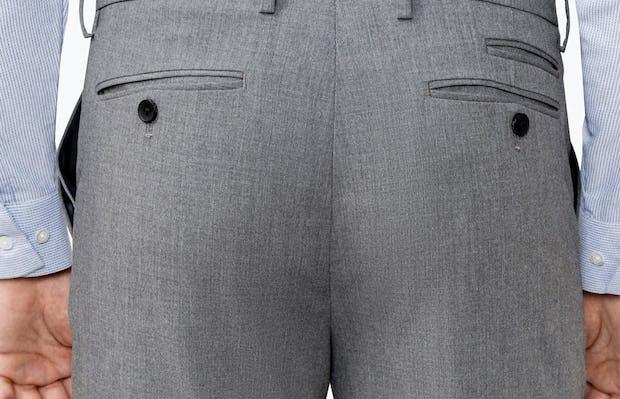 Close up of Men's Grey Velocity Pant on Model Facing Backward