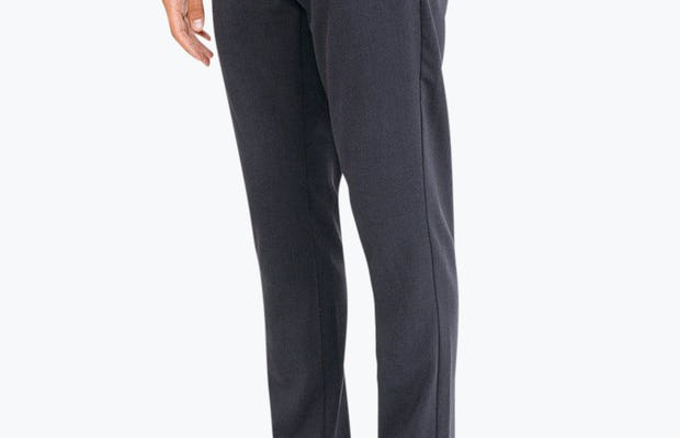 Men's Navy Velocity Dress Pant on Model facing left with hand in pocket