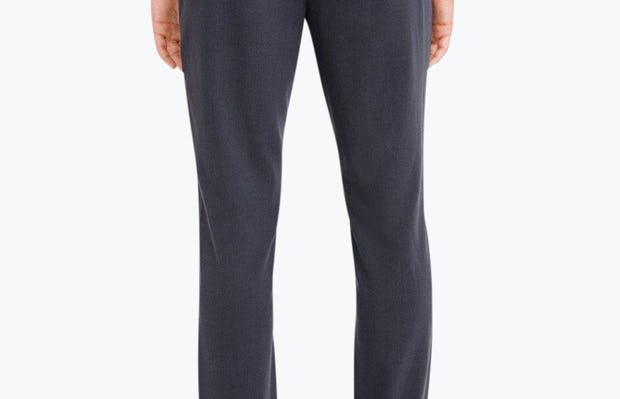 Men's Navy Velocity Dress Pant on model facing backward