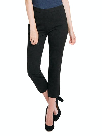 Women's Black Skinny Crop Kinetic Pants on Model Walking Forward