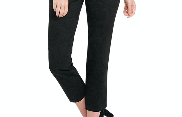 Women's Black Skinny Crop Kinetic Pants on Model Walking Forward