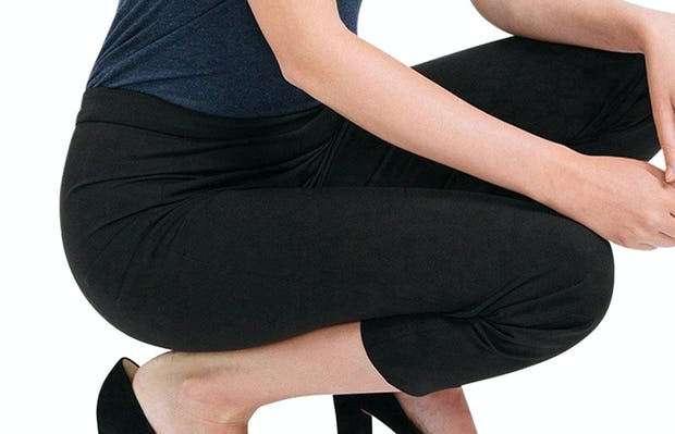 Women's Black Skinny Crop Kinetic Pants on Model squatting down