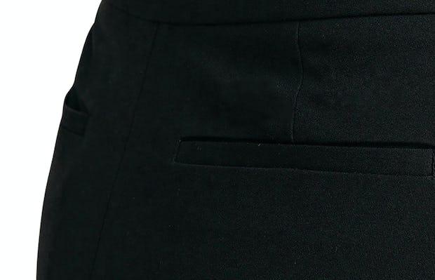 Close up of back pocket of Women's Black Skinny Crop Kinetic Pants on Model