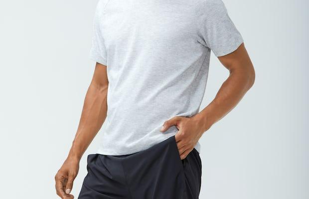 Men's Light Grey Composite Merino Active Tee and Men's Navy Newton Active Shorts on Model with hand in pocket