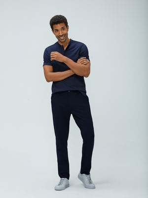 Men's Navy Composite Merino Short Sleeve Henley and Men's Navy Fusion Pant on model facing forward with crossed arms