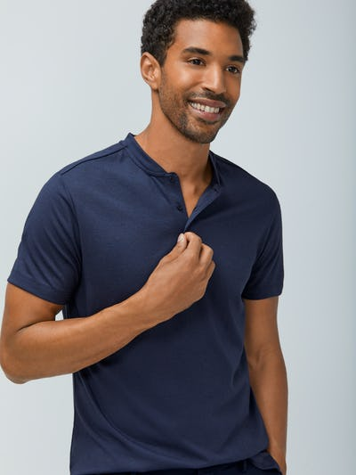 Close up of Men's Navy Composite Merino Short Sleeve Henley on model adjust buttons