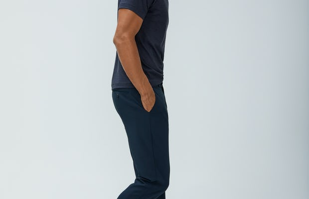 Men's Navy Composite Merino Tee and Men's Dark Navy Velocity Pant on model walking right