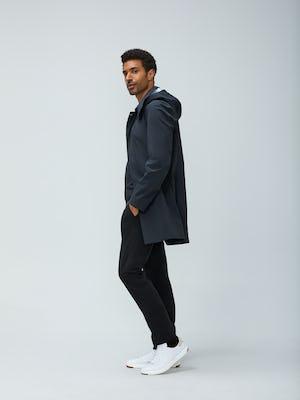 Men's Black Doppler Mac and Men's Black Velocity Pant on Model walking left