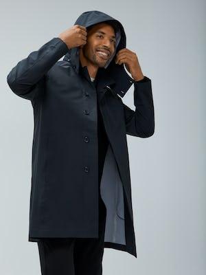 Close-up of Men's Black Doppler Mac on Model adjusting hood