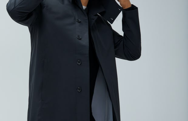 Close-up of Men's Black Doppler Mac on Model adjusting hood