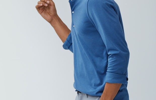 Mens Storm Blue Recycled Composite Merino Long Sleeve Henley - On Model