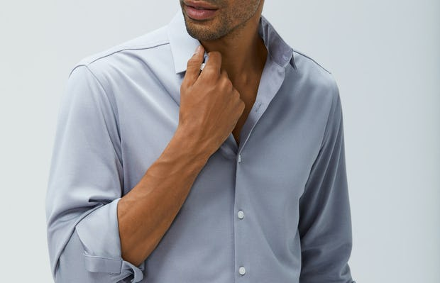 men's grey oxford recycled brushed apollo dress shirt model facing forward hand on collar