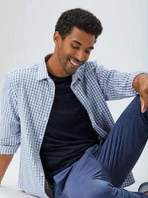 men's midnight stripe plaid aero zero dress shirt indigo heather kinetic pant navy composite merino tee model sitting shirt unbuttoned