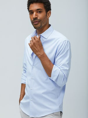 men's blue aero zero dress shirt sleeves rolled model facing forward