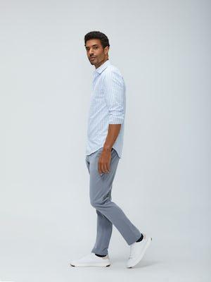 men's blue tattersall aero zero dress shirt and light grey momentum chino sleeves rolled model facing to the side