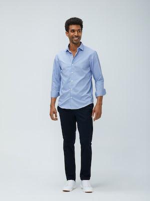 man's blue box plaid aero zero dress shirt and navy kinetic pant model facing forward sleeves rolled
