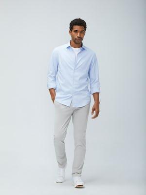 men's blue aero zero dress shirt and light khaki momentum chino sleeves rolled model facing forward