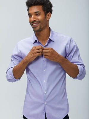 Men's lavender end on end aero dress shirt model facing forward sleeves rolled buttoning shirt