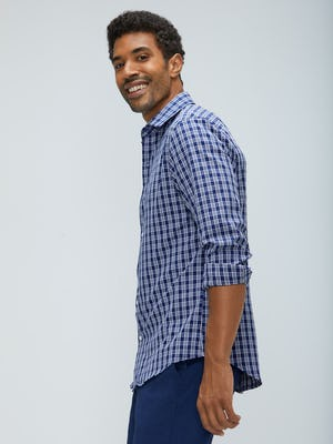 Men's midnight multi plaid aero zero dress shirt model facing to the side sleeves rolled