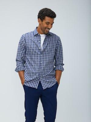 Men's midnight multi plaid aero zero dress shirt model facing forward sleeves rolled hands in pockets