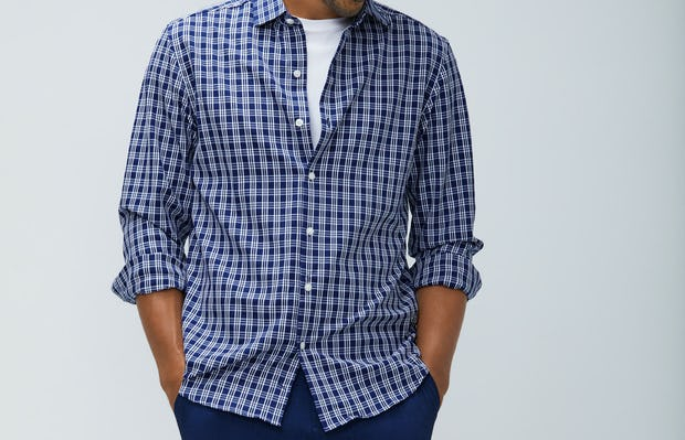 Men's midnight multi plaid aero zero dress shirt model facing forward sleeves rolled hands in pockets