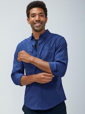 Men's indigo grey jasper grid aero button down model facing forward with sleeves rolled