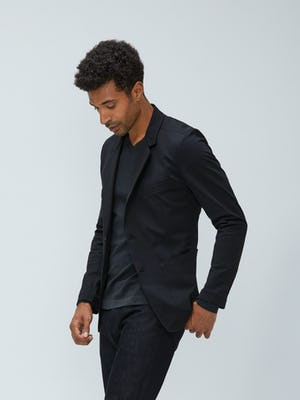 Men's Black Kinetic Blazer and Charcoal Static Atlas V-Neck Sweater on model walking left