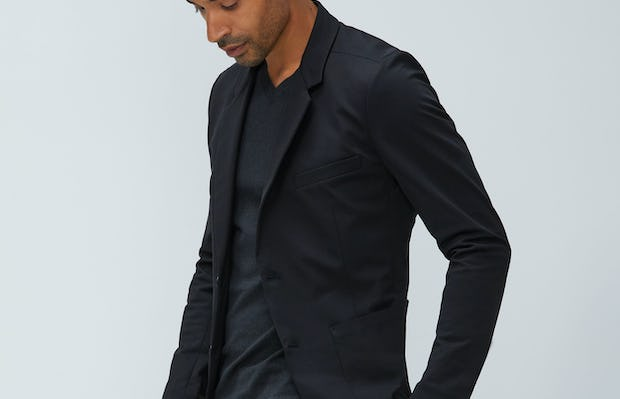 Men's Black Kinetic Blazer and Charcoal Static Atlas V-Neck Sweater on model walking left