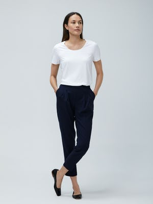 Women's White Luxe Touch Tee and Women's Navy Swift Drape Pant on Model facing forward with legs crossed